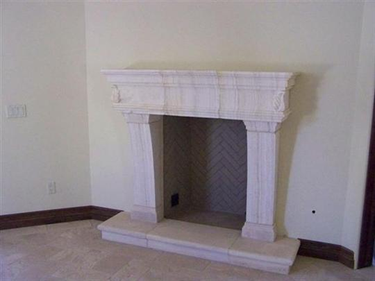 CANTERA HAND CARVED FIREPLACE FP111.jpg