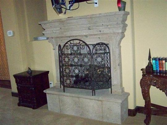 CANTERA HAND CARVED FIREPLACE FP072.jpg