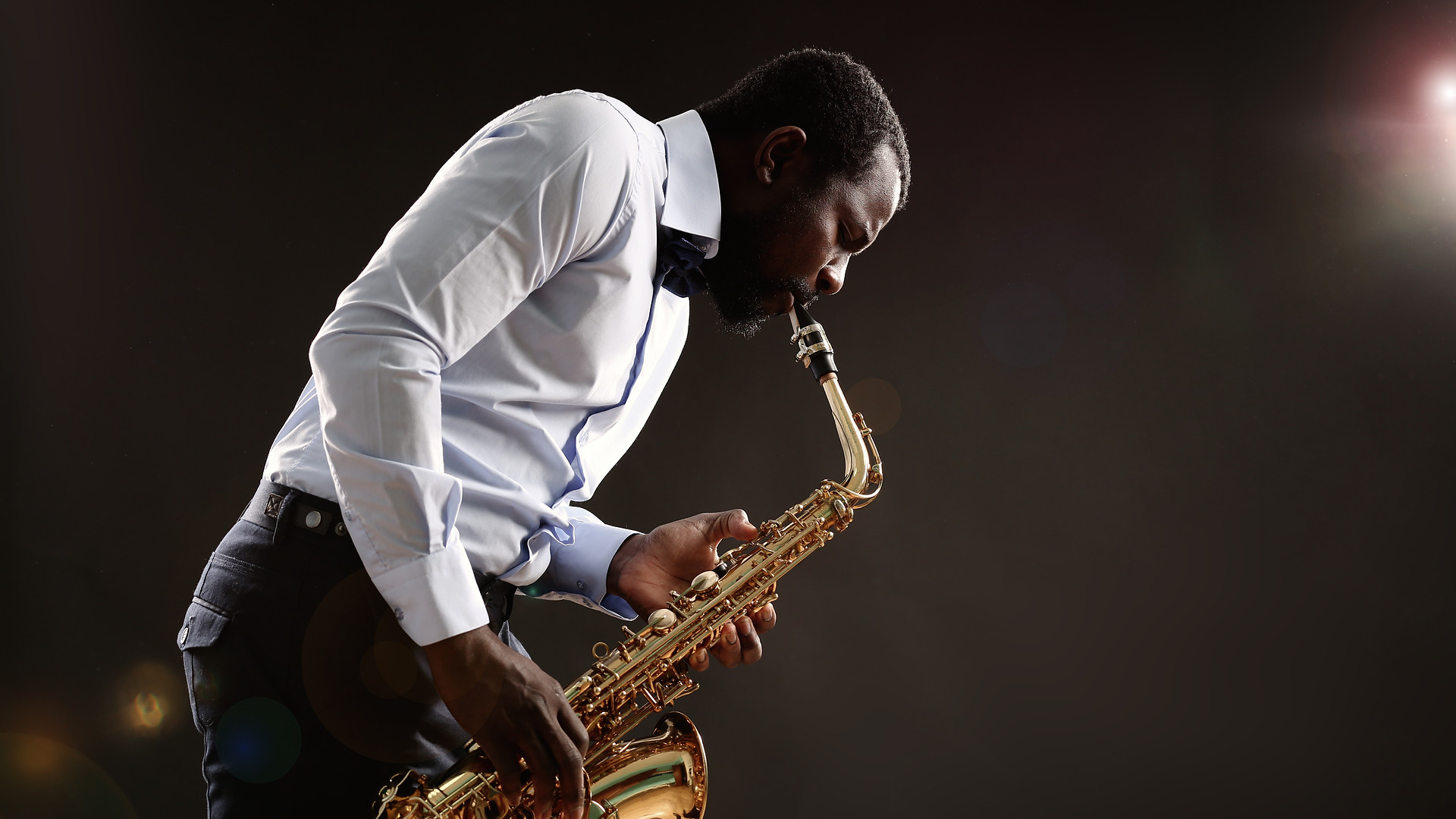 African American jazz musician playing t