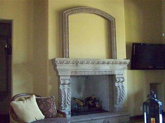 CANTERA HAND CARVED FIREPLACE FP070.jpg