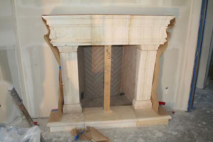 CANTERA HAND CARVED FIREPLACE FP093.jpg