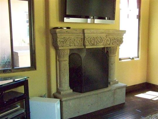 CANTERA HAND CARVED FIREPLACE FP071.jpg
