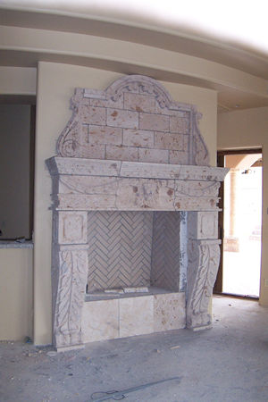 CANTERA HAND CARVED FIREPLACE FP048.jpg