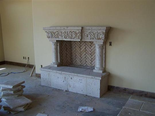 CANTERA HAND CARVED FIREPLACE FP099.jpg
