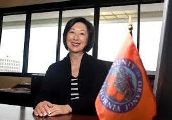 Supervisor Lisa Bartlett and County Flag