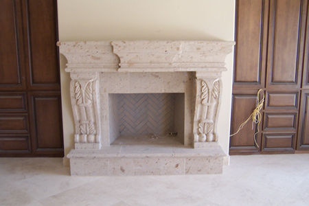 CANTERA HAND CARVED FIREPLACE FP104.jpg