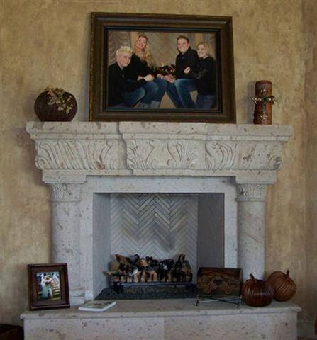 CANTERA HAND CARVED FIREPLACE FP011.jpg