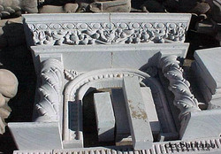 CANTERA HAND CARVED FIREPLACE FP146.jpg