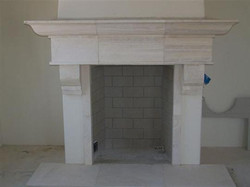 CANTERA HAND CARVED FIREPLACE FP119.jpg