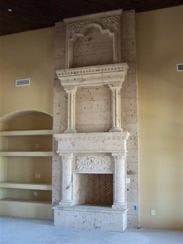 CANTERA HAND CARVED FIREPLACE FP129.jpg