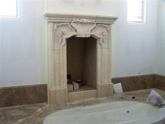 CANTERA HAND CARVED FIREPLACE FP125.jpg