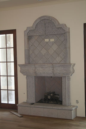 CANTERA HAND CARVED FIREPLACE FP061.jpg