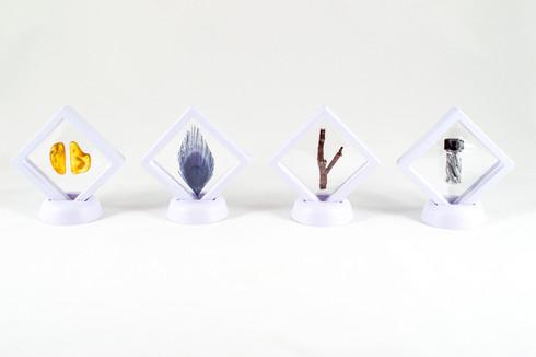 Uranus, 2018. Amber, peacock (feather) rowan and zinc.