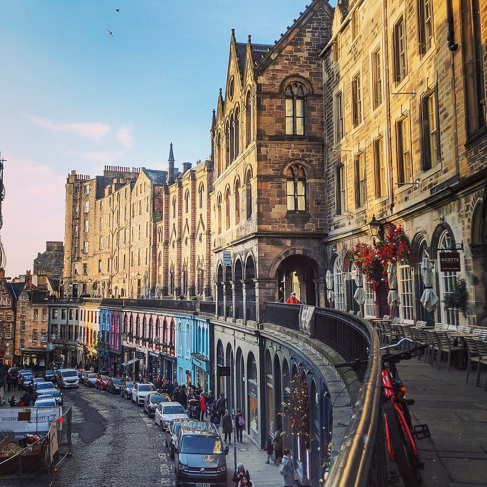 Cobbled Victoria Street in Edinburgh with sunlight on building facades