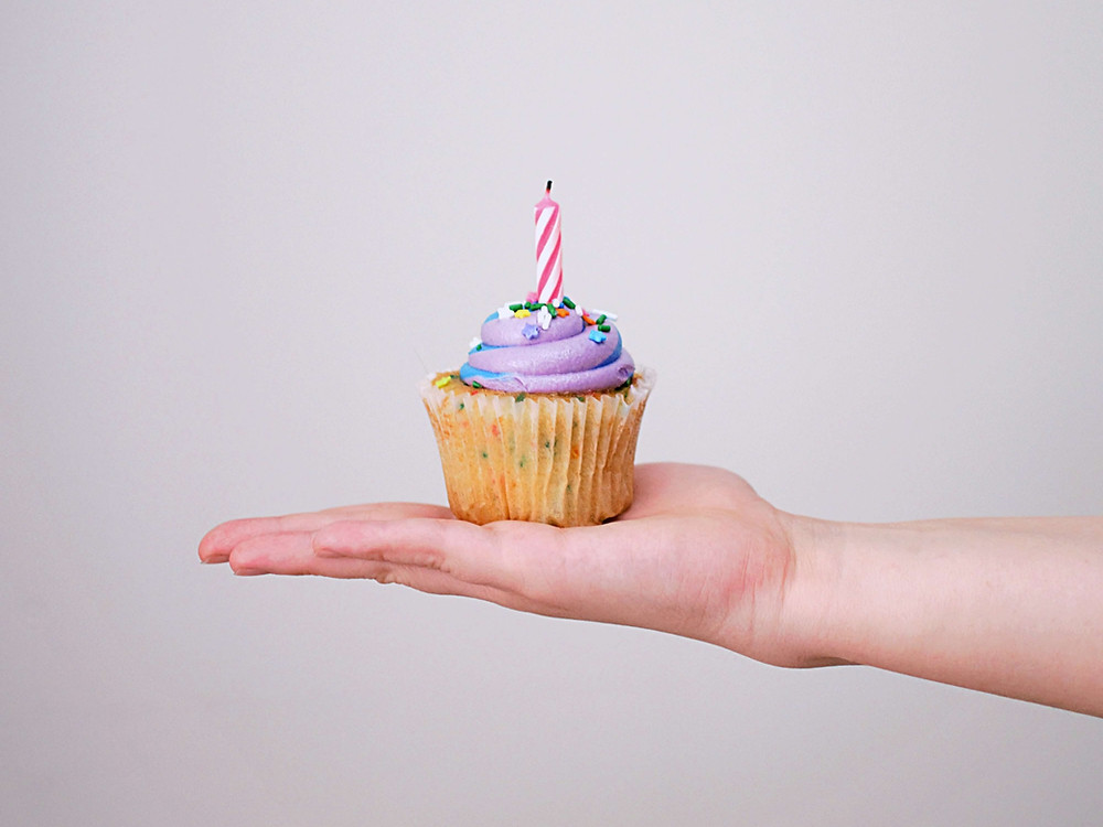 Birthday cupcake on an hand