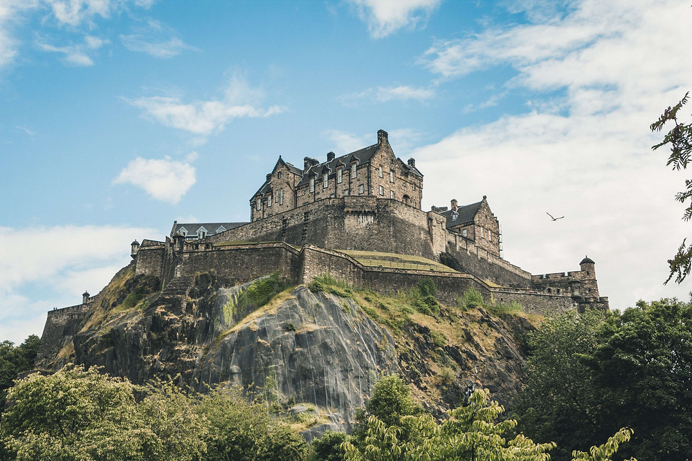Edinburgh Castle with blue skies and clouds in the background