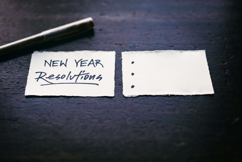 New Year resolutions written on scraps of paper