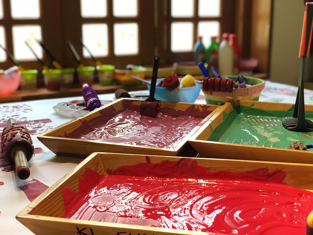 Coloured paints in wooden trays