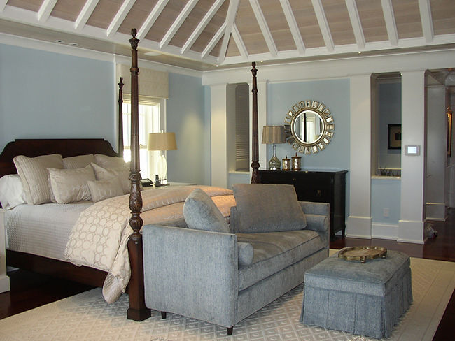 Blue and white beach front bedroom with custom wood ceiling