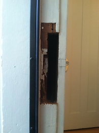 how to repair a split door frame; first remove all damaged wood