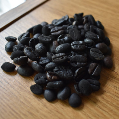 Black beans. Every roasting there are always few beans that get over roasted. It is a game to pick them out and save them.