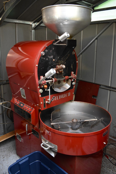 This is the coffee roaster.  The raw beans go in through the spout at the top, spin around in the very hot drum, and then are emptyed into the bottom basin to cool off.
