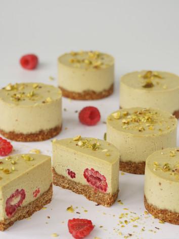 Vegan pistachio & raspberry cheesecakes