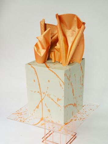 Concrete buttercream cake with metalic sail