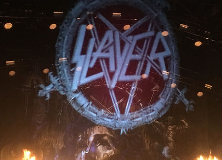 Slayer logo on front of stage curtain