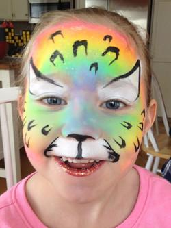 rainbow-leopard-panther-facepainting-fancy-faces-calgary-girl-glitter-lips.jpg