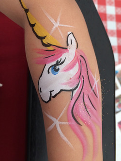 unicorn face paint pink hair.jpg