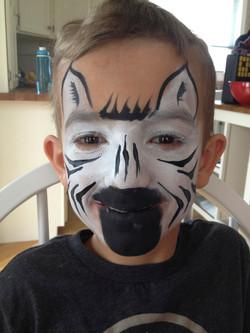 black-white-zebra-fancy-faces-facepainting-calgary-boy-black-muzzle-ears.jpg