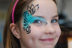 glamour-eye-face-painting-swirls-flourish-teal-blue-girl-makeup-sparkles.JPG