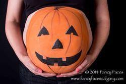 orange pumpkin prenatal belly body painting Fancy Faces Calgary.jpg
