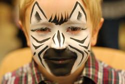 facepaint-white-and-black-zebra-face-paint-boy-black-muzzle-stripes.jpg