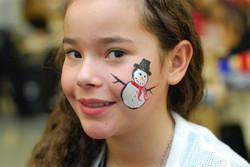 cheek-facepainting-snowman-red-scarf-orange-nose-girl-black-hat.jpg