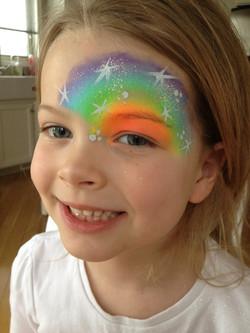 neon-rainbow-half-face-mask-fancy-faces-facepainting-calgary-white-stars-dots-gi
