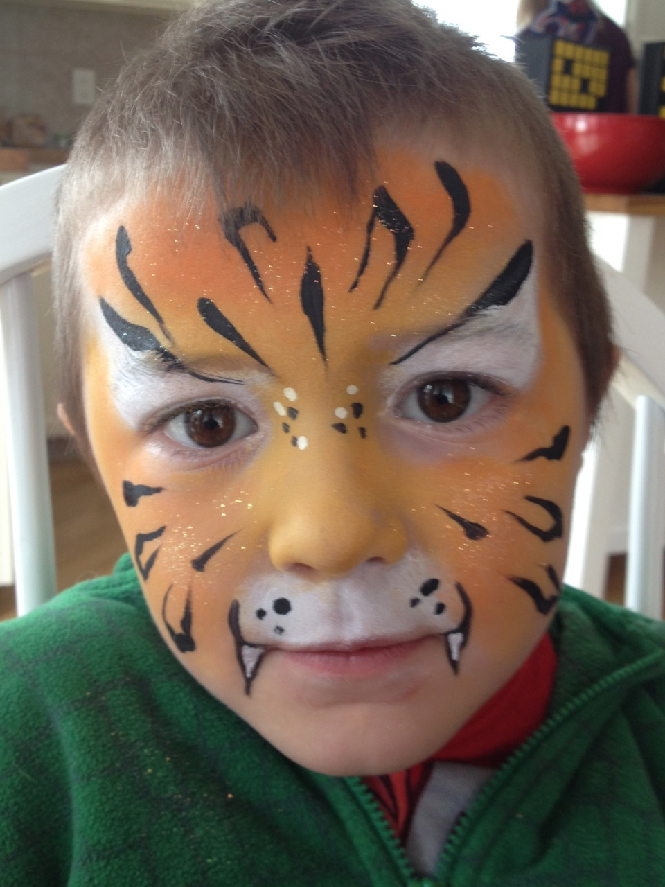 orange-tiger-fancy-faces-facepainting-calgary-boy-stripes-glitter-dots.jpg
