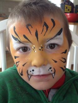 orange-tiger-fancy-faces-facepainting-calgary-boy-stripes-glitter-dots.jpg