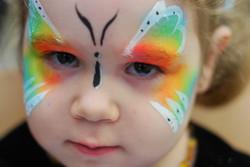 neon-rainbow-butterfly-face-paint-facepaint-white-outline-dots-girl.jpg