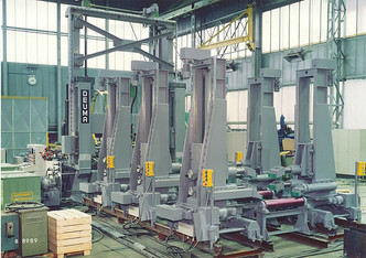 Mobile loading and clamping gantries to load, align and clamp flanges and web
