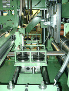 View inside a continuous panel welding machine with guide rolls and drive rollers