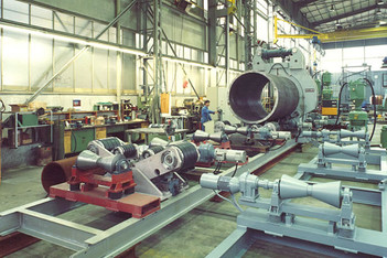 Part of pipe production line with heavy external clamping ring and tack welding unit