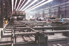 Workshop with a complete panel fabrication line, incl. panel welding machine, transport systems and turn-over devices.