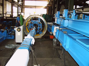 Clamping ring for the joint welding of pipe including internal circumferential seam welding manipulator