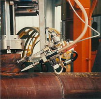 Fully automated machine for welding of nozzles into pipe, will be clamped into the nozzle