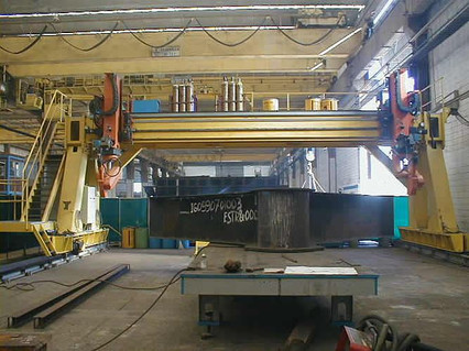 Heavy Gantry type equipment with 35 x 10m working range, 2x6 Robotic axes and 6 external axes from DEUMA