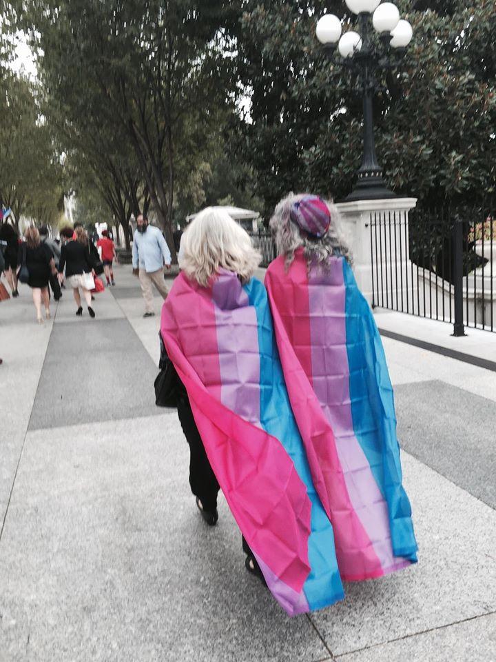 Wearing transgender pride flags