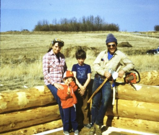 Cindy with her parents and brother on the Alberta farm