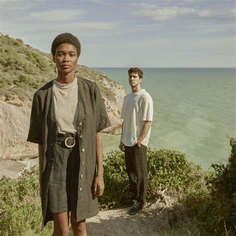 Black woman and white man wearing Trace Collective clothes